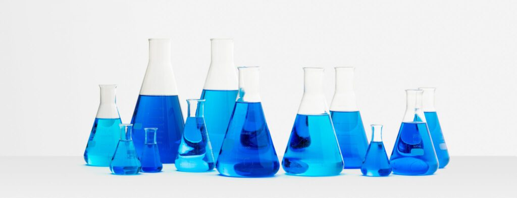 "<img src=""conicalflask.jpg"" alt=""conical flask filled with blue liquid sample"">"
